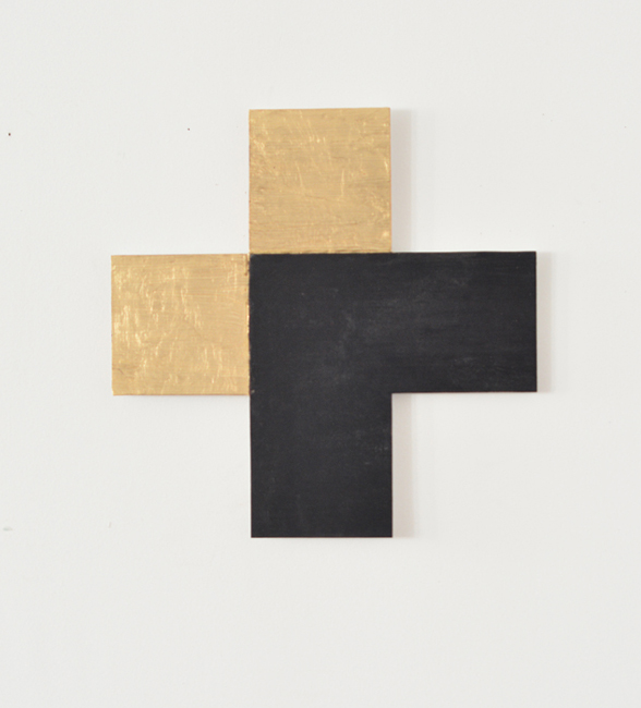 This wall sculpture by Sjack Marks is created from two sides of a gold square over layed by two sides of a black square